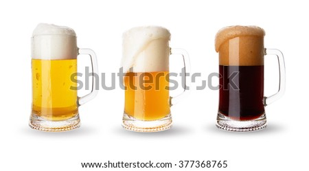 Three glasses with different beers on a white background - stock photo