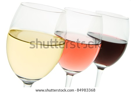 three glasses with white, rose and red wine