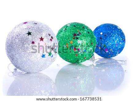 Three glistering Christmas ball toys close up