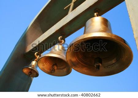 three gold bells - stock photo