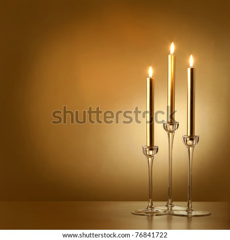 three gold candles - stock photo