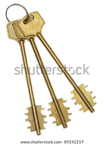 Three gold keys. It is isolated on a white background - stock photo