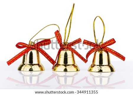 Three golden bell Christmas decorations with reflection isolated on white background - stock photo