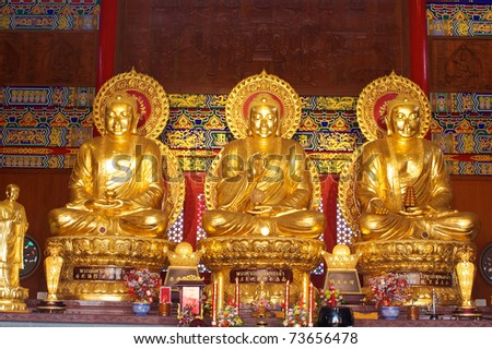 three golden buddha at the dragon temple - stock photo