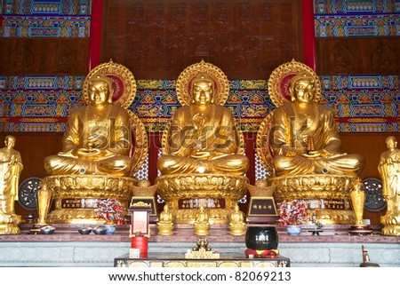 Three golden buddha state in Chinese temple, Thailand - stock photo