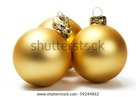 three golden dull christmas balls on white background - stock photo