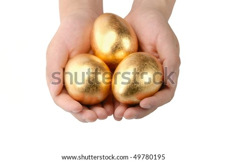 Three golden egg in the hands