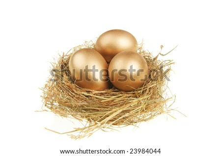 Three golden eggs in a nest of straw