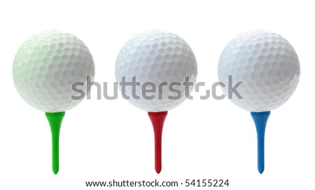 Three golf balls on green red and blue tees - stock photo