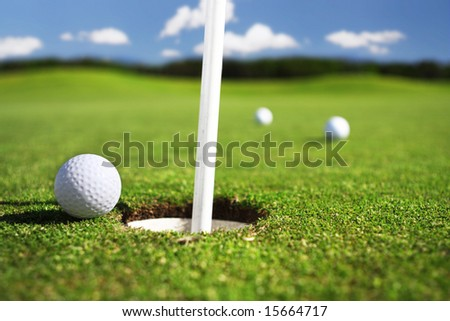 three golfballs - stock photo