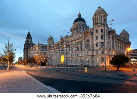 Three Graces and Liver building on waterfront in Liverpool, England - stock photo