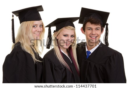 Three graduates standing together in their gowns, isolated on white
