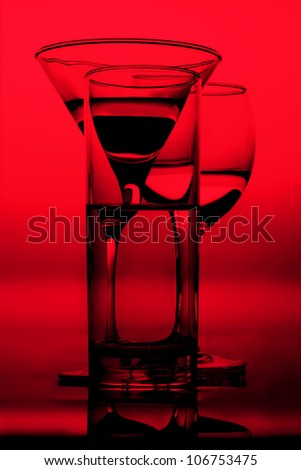 three graphic glasses of red wine of white wine on it is black ared background silhouettes in a bright wine shades of black outlines - stock photo