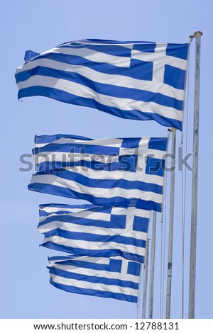 Three greek flags against blue sky - stock photo