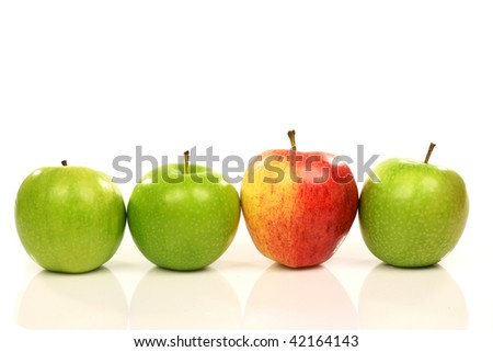 three green and one red apple on a white background