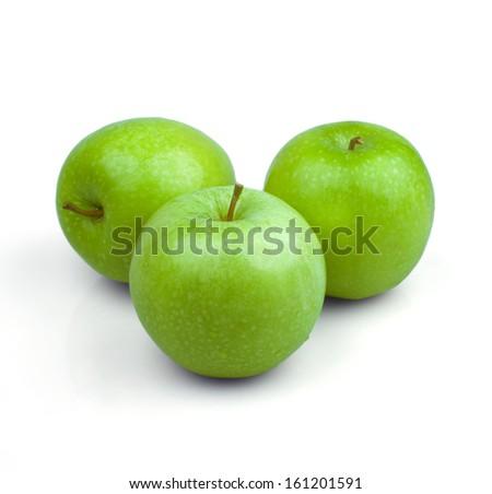 Three green apple on a white background - stock photo