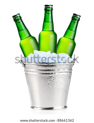Three green beer bottles in ice