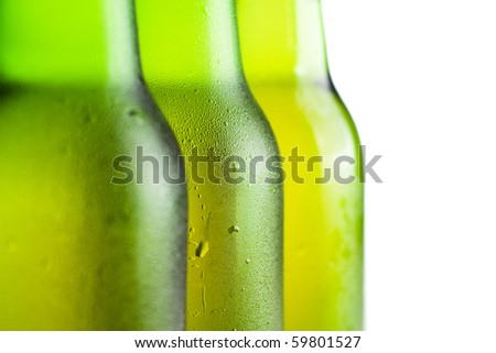 three green beer bottles over white background - stock photo