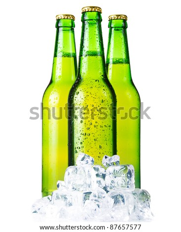 Three green bottles of beer with ice isolated on white background