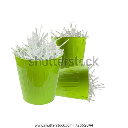 three green cans full of shredded paper on a white background - stock photo