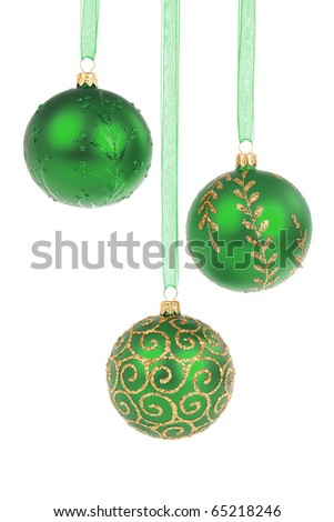 Three green Christmas baubles hanging isolated on white background - stock photo