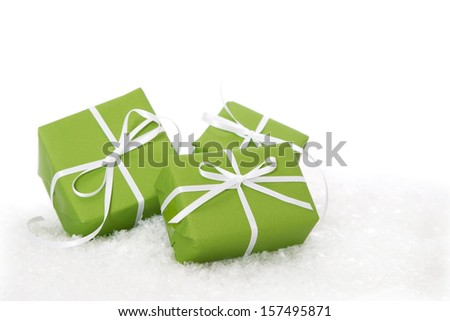Three green Christmas gift boxes isolated on white background  - stock photo