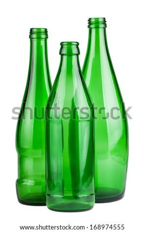 Three green empty bottles isolated on white background - stock photo
