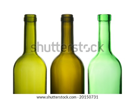 Three green empty wine bottles in a row.