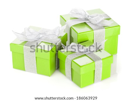 Three green gift boxes with silver ribbon and bow. Isolated on white background - stock photo