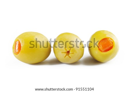 three green olives on white background