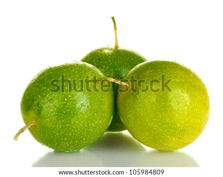 three green passion fruit isolated on white - stock photo