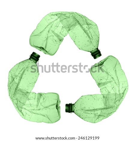 three green plastic bottles forming the symbol of recycling  - stock photo