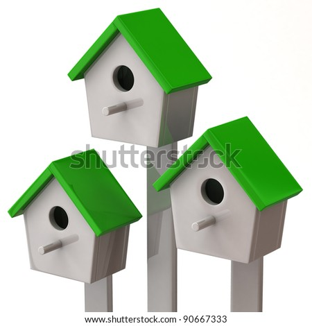 Three green starling house isolated on white background - stock photo