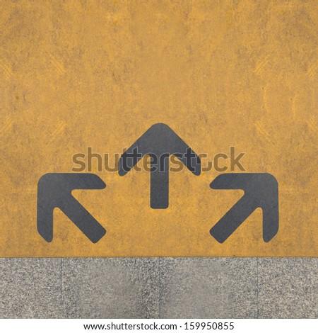 Three grey arrows on the yellow background - stock photo