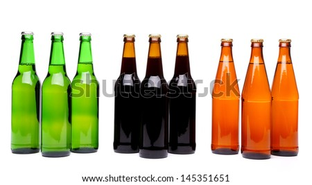 Three groups beer bottles. On white background