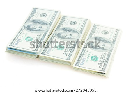 three growing  piles of dollars money isolated on white background