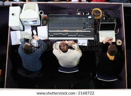 Three guys at audio control - stock photo