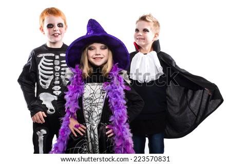 Three halloween characters: witch, skeleton, vampire. Studio portrait isolated over white background - stock photo