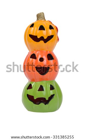 Three halloween pumpkin heads, yellow, orange and green on white background.