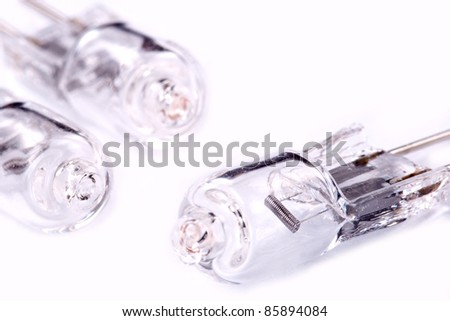 Three halogen lamps on a light grey background
