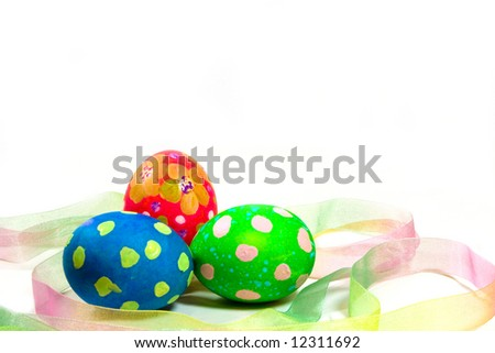 Three hand painted Easter eggs with ribbon on a white background. - stock photo