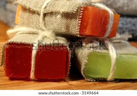 Three handmade soap on a bamboo mat - stock photo