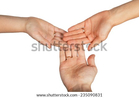 Three hands with wedding rings isolated on red background - stock photo