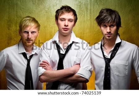Three handsome guys - stock photo