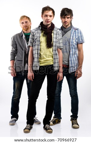 Three handsome guys indoors - stock photo