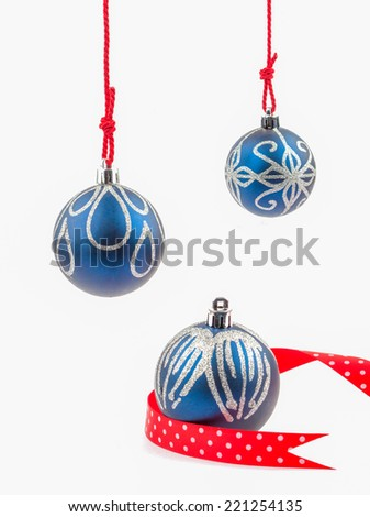 Three hanging Christmas baubles isolated on white. - stock photo
