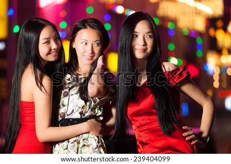 Three happy asian girls in Beijing - stock photo