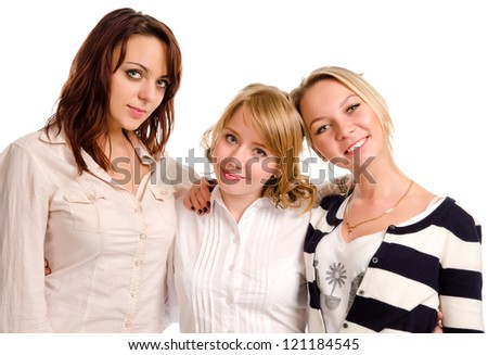 Three happy attractive young female friends socialising together standing in a row smiling at the camera isolated on white - stock photo