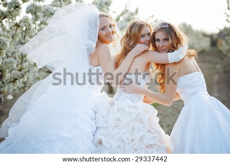 Three happy beautiful brides together - stock photo