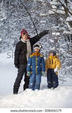 three happy boys in forest play - stock photo